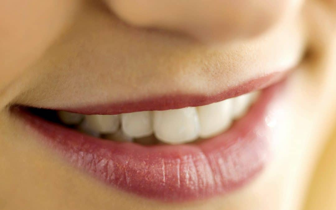 Woman smiling, close up of nose, lips, teeth