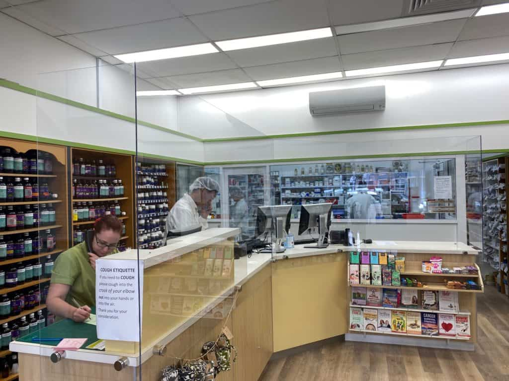 Shop interior at Visionary Health Compounding Chemist showing perspex safety screens in place