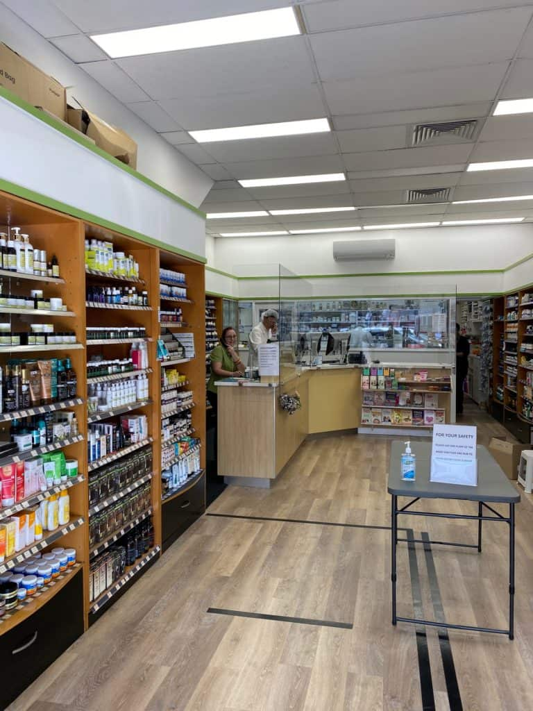 Shop interior at Visionary Health Compounding Chemist showing hand sanitising station